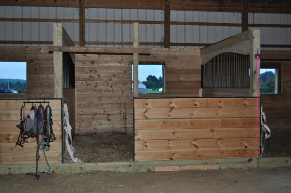 Barn improvements part 2 custom arched horse stalls for Building a horse stable